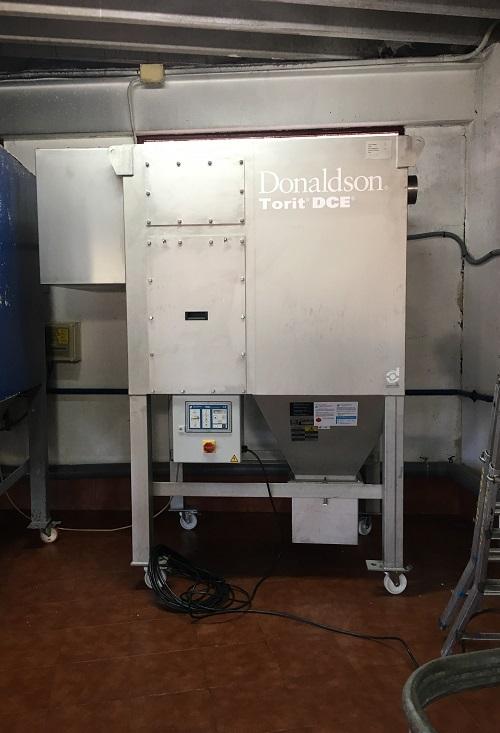 Instalación de equipo de captación de polvo en acero inoxidable